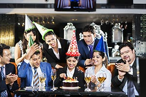 Business people celebrating their colleagues birth