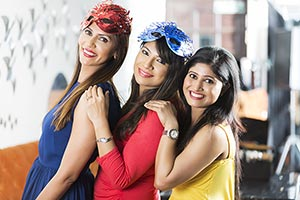 3 Friends women Stading Pose in Hotel New Year Par