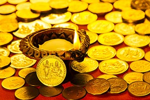 Deepawali Gold Coins with Diya Burning