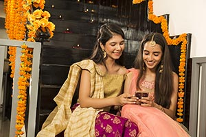 Sister Girls Reading Messaging Phone Diwali