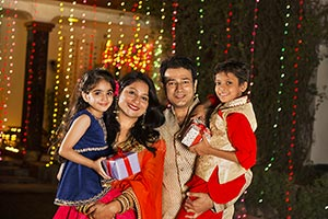 Indian Parents And Kids Diwali Gift Celebration