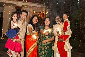 Joint Family Celebrating Diwali Festival Fire Crac