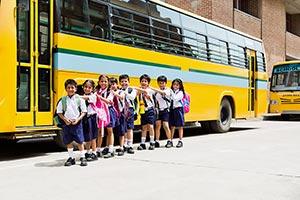 Bag ; Boys ; Buildings ; Bus ; Carefree ; Carrying